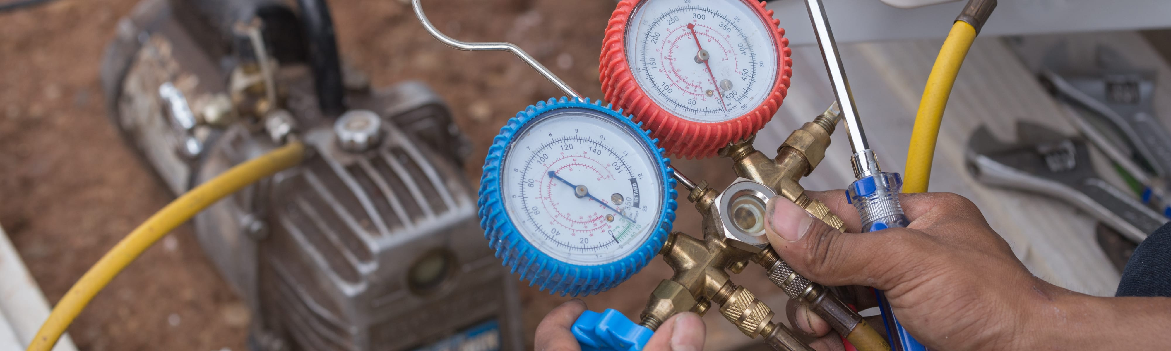 Vacuum pump evacuates air from the air conditioner.