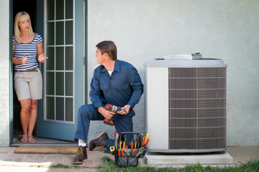 Technician talking to customer about the new AC regulations