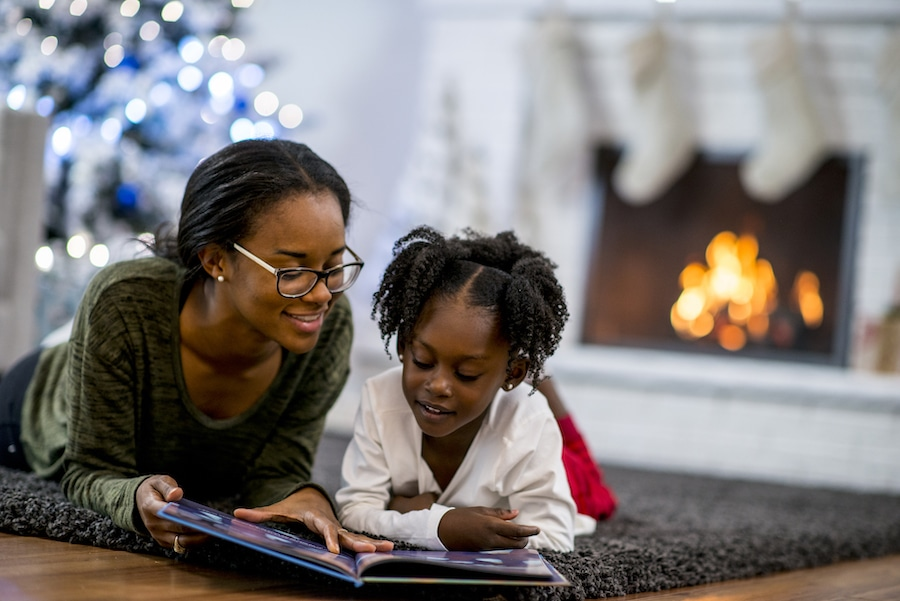 Mother and daughter relaxing in the winter after understanding the ways they can save money on their heating bill this winter.
