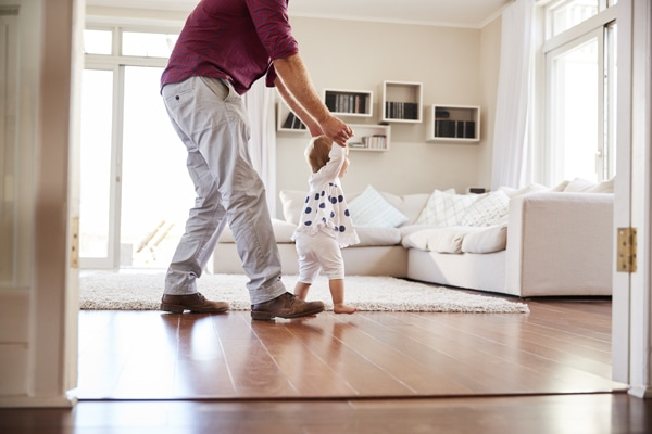 happy father and child in clean room to show how your indoor air quality accessories can help keep you safe.