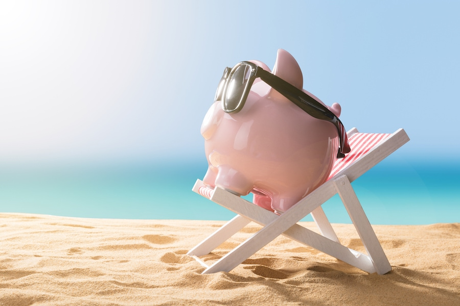 Piggy bank on the beach representing the financing options for affording a new AC system or other HVAC equipment.