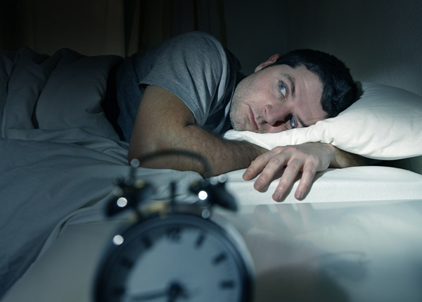 man not able to sleep at night because his air conditioner is making noise.